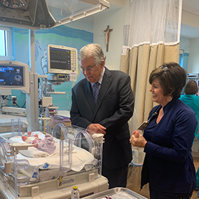 Ascension Sacred Heart Emerald Coast President Roger Hall and VP of Nursing BJ Fontaine watch over baby-girl McKinley Smith from Crestview, who was born seven weeks early and - along with her twin brother Emerson - is now one of the first patients in the hospital's new neonatal intensive care unit.