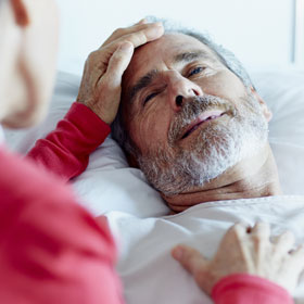 Man in bed receiving palliative care
