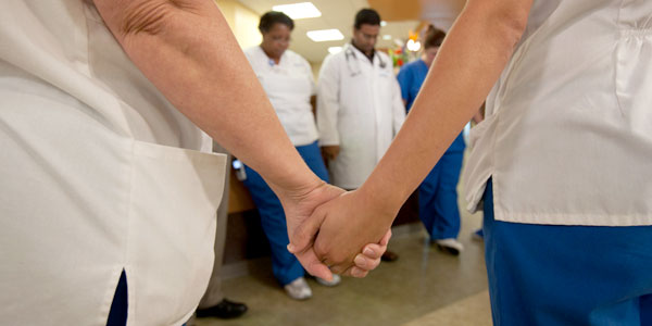 Group of Ascension hospital employees holding hands